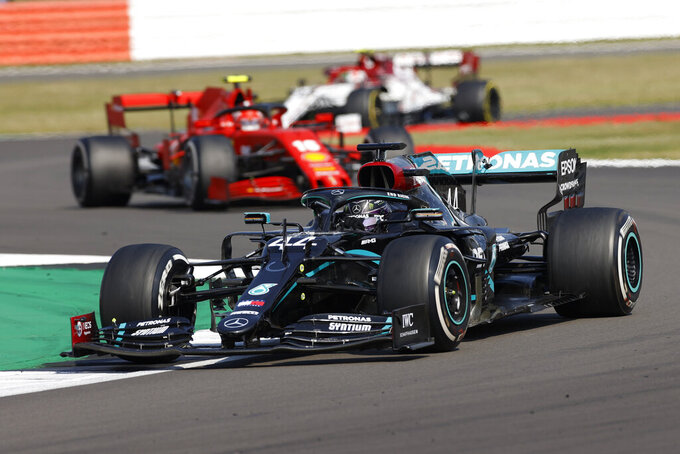 Mercedes driver Lewis Hamilton of Britain steers his car during the 70th Anniversary Formula One Grand Prix at the Silverstone circuit, Silverstone, England, Sunday, Aug. 9, 2020. (Andrew Boyers, Pool via AP)