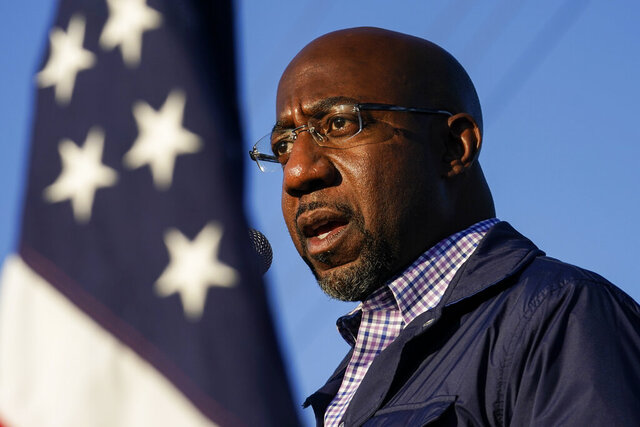 FILE - In this Nov. 15, 2020, file photo Raphael Warnock, a Democratic candidate for the U.S. Senate, speaks during a campaign rally in Marietta, Ga. Warnock and U.S. Sen. Kelly Loeffler are in a runoff election for the Senate seat. (AP Photo/Brynn Anderson, File)