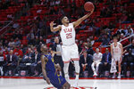 Utah guard Alfonso Plummer (25) lays the ball up as California guard Joel Brown defends during the second half of an NCAA college basketball game Saturday, Feb. 8, 2020, in Salt Lake City. (AP Photo/Rick Bowmer)