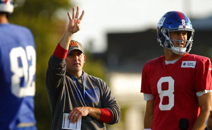 New York Giants head coach Joe Judge, left, signals a play during an NFL football training camp Saturday, July 31, 2021, in Newark, N.J. (AP Photo/John Munson)