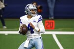 FILE - In this Sunday, Oct. 4, 2020 file photo, Dallas Cowboys quarterback Dak Prescott drops back to pass in the first half of an NFL football game against the Cleveland Browns in Arlington, Texas. Applying franchise and even transition tags to players can have major ramifications on a team's present and future. That was never more of a consideration than this year, with the salary cap decreasing by, for now, $18 million. That's the first time the cap has gone down, which is due to lost revenues caused by the COVID-19 pandemic. (AP Photo/Ron Jenkins, File)
