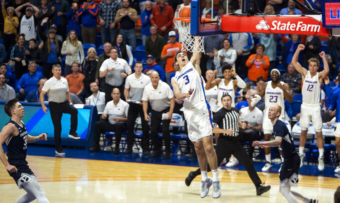Boise State guard Justinian Jessup dunks in overtime against BYU during an NCAA college basketball game Wednesday, Nov. 20, 2019, in Boise, Idaho. Boise State won 72-68. (Darin Oswald/Idaho Statesman via AP)
