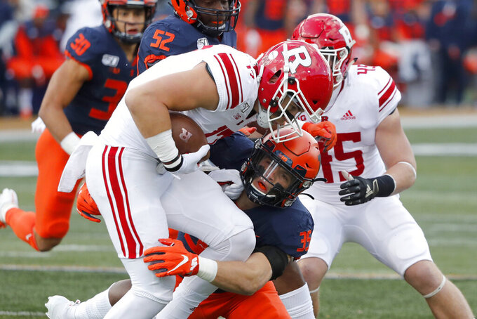 Illinois linebacker Jake Hansen (35) tackles Rutgers quarterback Johnny Langan for a loss during the first half of an NCAA college football game Saturday, Nov. 2, 2019, in Champaign, Ill. (AP Photo/Charles Rex Arbogast)