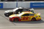 Joey Logano (22) races Kurt Busch (1) during a NASCAR Cup Series auto race at Michigan International Speedway in Brooklyn, Mich., Sunday, Aug. 11, 2019. (AP Photo/Paul Sancya)