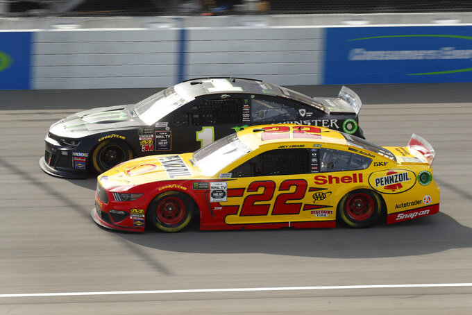 Joey Logano (22) races Kurt Busch (1) during a NASCAR Cup Series auto race at Michigan International Speedway in Brooklyn, Mich., Sunday, Aug. 11, 2019. (AP Photo/Paul Sancya)