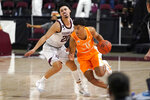 Tennessee guard Jaden Springer (11) dribble past Texas A&M guard Andre Gordon (20) during the first half of an NCAA college basketball game Saturday, Jan. 9, 2021, in College Station, Texas. (AP Photo/Sam Craft)
