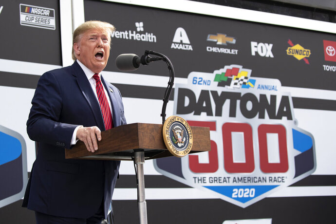 """FILE - In this Feb. 16, 2020, file photo, President Donald Trump speaks before the start of the NASCAR Daytona 500 auto race at Daytona International Speedway, Sunday n Daytona Beach, Fla. NASCAR's layered relationship with Trump took a sharp turn Monday, July 6, 2020, when Trump blasted the series for banning the Confederate flag and wrongly accused the sport's only full-time Black driver of perpetrating """"a hoax"""" when a crew member found a noose in the team garage stall.(AP Photo/Alex Brandon, File)"""