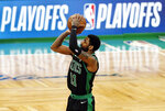 Boston Celtics' Kyrie Irving shoots against the Indiana Pacers during the first quarter in Game 1 of a first-round NBA basketball playoff series, Sunday, April 14, 2019, in Boston. (AP Photo/Winslow Townson)