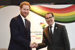 Britain's Prince Harry meets with Saadeddine Othmani, Prime Minister of Morocco, right, at the UK Africa Investment Summit in London, Monday Jan. 20, 2020. Britain's Prime Minister Boris Johnson is hosting 54 African heads of state or government in London, as the U.K. prepares for post-Brexit dealings with the world. (Stefan Rousseau/Pool via AP)