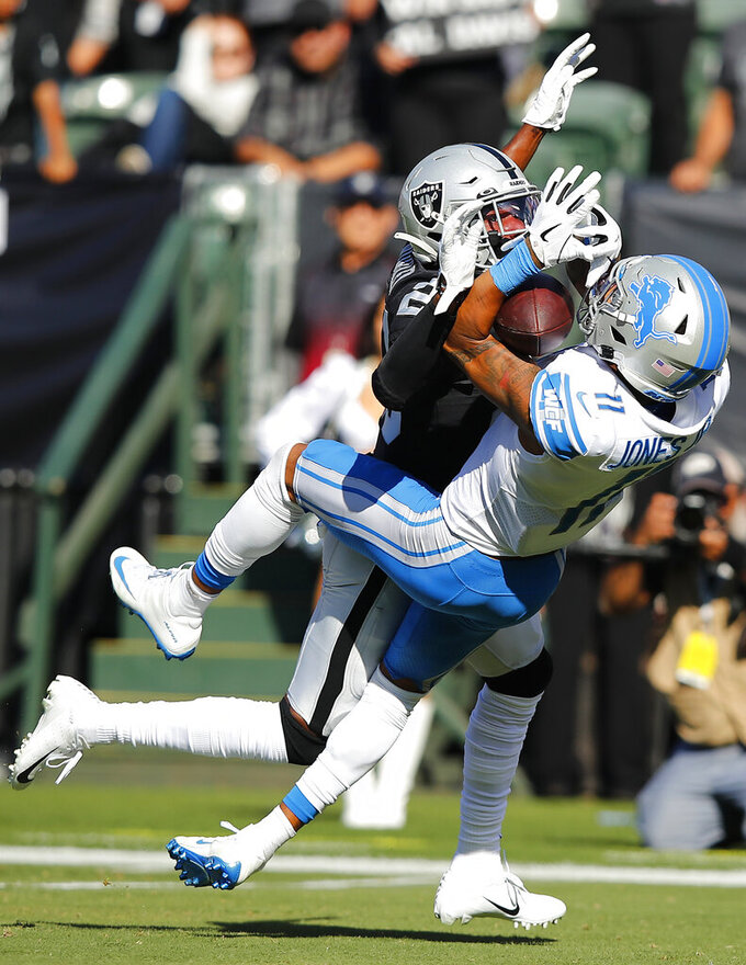Detroit Lions wide receiver Marvin Jones Jr. (11) catches a pass against Oakland Raiders defensive back Daryl Worley during the first half of an NFL football game in Oakland, Calif., Sunday, Nov. 3, 2019. (AP Photo/John Hefti)