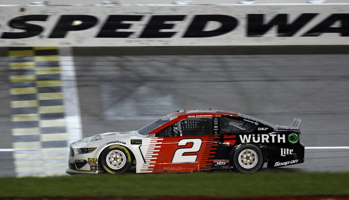Brad Keselowski crosses the finish line to win the NASCAR Cup Series auto race at Kansas Speedway in Kansas City, Kan., Saturday, May 11, 2019. (AP Photo/Colin E. Braley)
