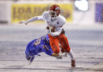 Fresno State wide receiver Derrion Grim (7) is tripped up by Boise State linebacker Tyson Maeva (58) after a reception during the first half of an NCAA college football game for the Mountain West championship Saturday, Dec. 1, 2018, in Boise, Idaho. (AP Photo/Steve Conner)
