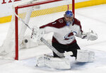 Colorado Avalanche goalie Semyon Varlamov, of Russia, blocks a shot in the first period of an NHL hockey game against the Minnesota Wild, Tuesday, March 13, 2018, in St. Paul, Minn. (AP Photo/Jim Mone)
