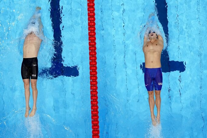 Ryan Murphy, and Bryce Mefford, of the United States, start the men's 200-meter backstroke semifinal at the 2020 Summer Olympics, Thursday, July 29, 2021, in Tokyo, Japan. (AP Photo/Morry Gash)