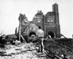 FILE - In this Sept. 13, 1945, file photo, the Urakami Catholic Cathedral in Nagasaki, Japan, stands waste in the aftermath of the detonation of the atom bomb over a month ago over this city. The city of Nagasaki in southern Japan marks the 75th anniversary of the U.S. atomic bombing of Aug. 9, 1945. It was a second nuclear bomb dropped by the U.S. three days after it made the world's first atomic attack on Hiroshima. Japan surrendered on Aug. 15, ending World War II and its nearly a half-century aggression toward Asian neighbors. Dwindling survivors, whose average age exceeds 83, increasingly worry about passing their lessons on to younger generations.(AP Photo/Stanley Troutman, Pool, File)