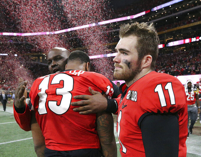 FILE- In this Jan. 8, 2018, file photo, Georgia's Jake Fromm and Jonathan Ledbetter reacts after their overtime lose to  Alabama in College Football Playoff National Championship in Atlanta. Saturday's SEC Championship, is the game the Bulldogs have wanted since last January, when the Alabama pulled out a 26-23 overtime victory in the national championship game. (Curtis Compton/Atlanta Journal-Constitution via AP)