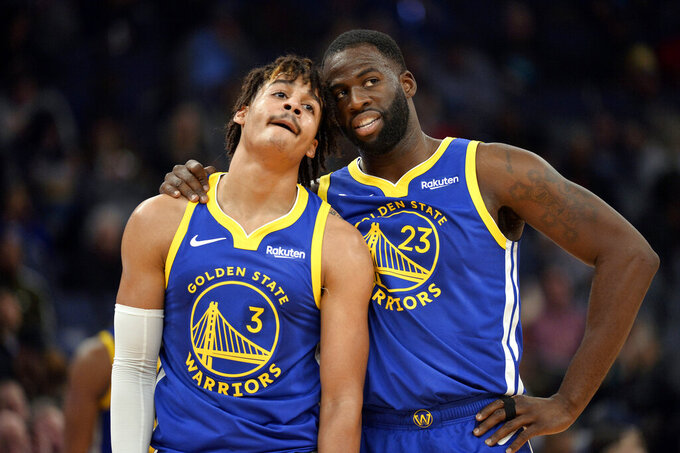 FILE - In this Nov. 19, 2019, file photo, Golden State Warriors guard Jordan Poole (3) and forward Draymond Green (23) talk during a break in the first half of an NBA basketball game against the Memphis Grizzlies in Memphis, Tenn. (AP Photo/Brandon Dill, File)