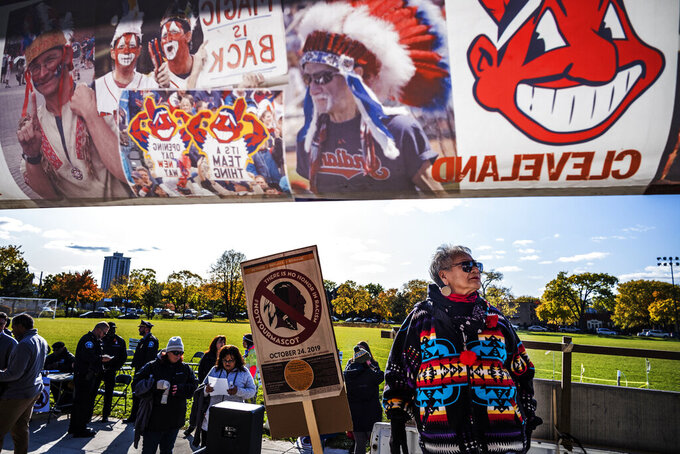 "Protesters, including Marcy Hart of the White Earth Nation, march from Peavey Park to US Bank Stadium to protest the use of ""Redskins"" in the name of the Washington NFL football team, before Washington's game against the Minnesota Vikings on Thursday, Oct. 24, 2019, in Minneapolis. Protesters also had signs about the Kansas City Chiefs, the Cleveland Indians and the Atlanta Braves. (Richard Tsong-Taatrarii/Star Tribune via AP)"