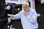 North Carolina head coach Roy Williams directs his team during the second half of an NCAA college basketball game against Notre Dame in the second round of the Atlantic Coast Conference tournament in Greensboro, N.C., Wednesday, March 10, 2021. (AP Photo/Gerry Broome)