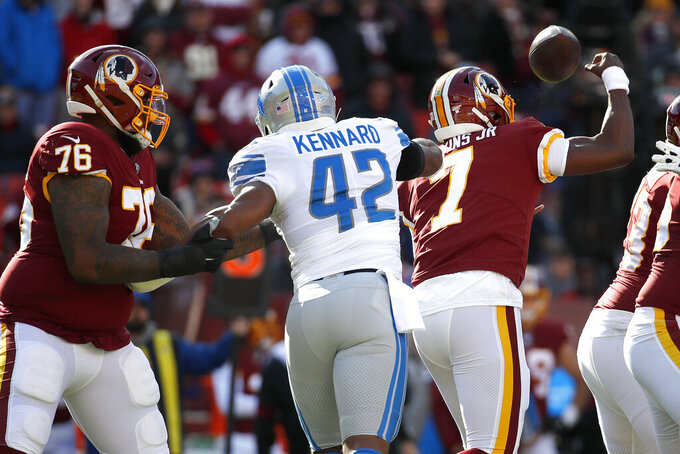 Washington Redskins quarterback Dwayne Haskins (7) fumbles the ball after taking a hit from Detroit Lions outside linebacker Devon Kennard (42) during the first half of an NFL football game, Sunday, Nov. 24, 2019, in Landover, Md. The ball was recovered by the Lions. Redskins Morgan Moses (76) tries to help defend on the play. (AP Photo/Alex Brandon)