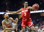 Ohio State's C.J. Jackson (3) reaches for a loose ball as it goes out of bounds as Houston's Galen Robinson Jr. watches during the first half of a second round men's college basketball game in the NCAA Tournament Sunday, March 24, 2019, in Tulsa, Okla. (AP Photo/Jeff Roberson)