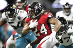 Atlanta Falcons running back Devonta Freeman (24) runs against the Jacksonville Jaguars during the second half of an NFL football game, Sunday, Dec. 22, 2019, in Atlanta. (AP Photo/Danny Karnik)