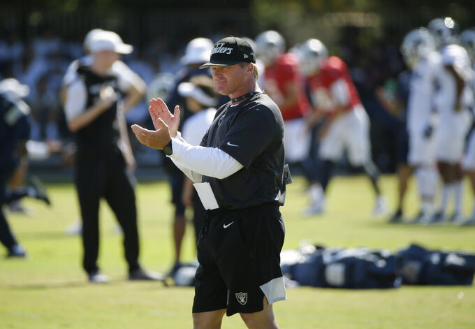Oakland Raiders head coach Jon Gruden claps during NFL football training camp Thursday, Aug. 8, 2019, in Napa, Calif. Both the Oakland Raiders and the Los Angeles Rams held a joint practice before their upcoming preseason game on Saturday. (AP Photo/Eric Risberg)