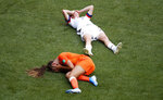 Netherlands' Lieke Martens and United States' Kelley O Hara lie on the pitch during the Women's World Cup final soccer match between US and The Netherlands at the Stade de Lyon in Decines, outside Lyon, France, Sunday, July 7, 2019. (AP Photo/Francois Mori)