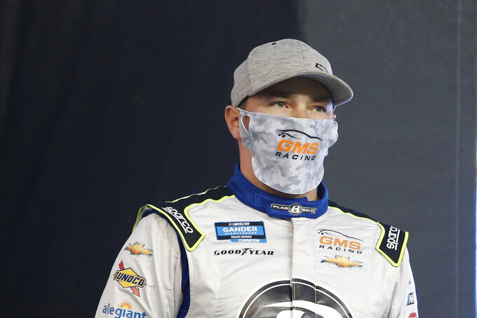 Brett Moffitt looks on from the driver introductions stage prior to the NASCAR Truck Series auto race at Phoenix Raceway, Friday, Nov. 6, 2020, in Avondale, Ariz. (AP Photo/Ralph Freso)