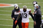 Cleveland Browns' Odell Beckham Jr. (13) leaves the field after being injured during the first half of an NFL football game against the Cincinnati Bengals, Sunday, Oct. 25, 2020, in Cincinnati. Browns star wide receiver Odell Beckham Jr. will miss the rest of the season after tearing a knee ligament during Sunday's 37-34 win at Cincinnati. (AP Photo/Michael Conroy)
