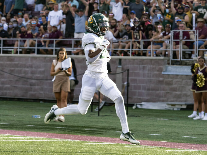 Baylor safety JT Woods returns an interception for a touchdown during the first half of the team's NCAA college football game against Texas State, Saturday, Sept. 4, 2021, in San Marcos, Texas. (AP Photo/Michael Thomas)