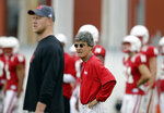 Nebraska quarterbacks coach Mario Verduzco follows practice behind head coach Scott Frost, during NCAA college football fall practice in Lincoln, Neb., Wednesday, Aug. 8, 2018. Nebraska's three-man quarterback race remains too close to call. Quarterbacks coach Mario Verduzco says Adrian Martinez, Tristan Gebbia and Andrew Bunch continue to get an equal number of snaps with the first-string offense. (AP Photo/Nati Harnik)