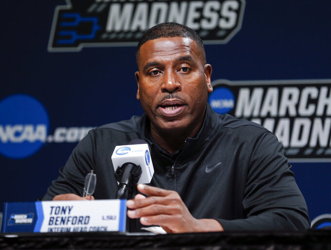 LSU interim head coach Tony Benford answers questions during a news conference at the NCAA men's college basketball tournament in Jacksonville, Fla., Friday, March 22, 2019. LSU faces Maryland in the second round on Saturday. (AP Photo/Stephen B. Morton)