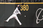 Seattle Mariners right fielder Mitch Haniger can't catch a deep fly ball that fell in for a triple by Boston Red Sox's Xander Bogaerts during the eighth inning of a baseball game Tuesday, Sept. 14, 2021, in Seattle. (AP Photo/Elaine Thompson)