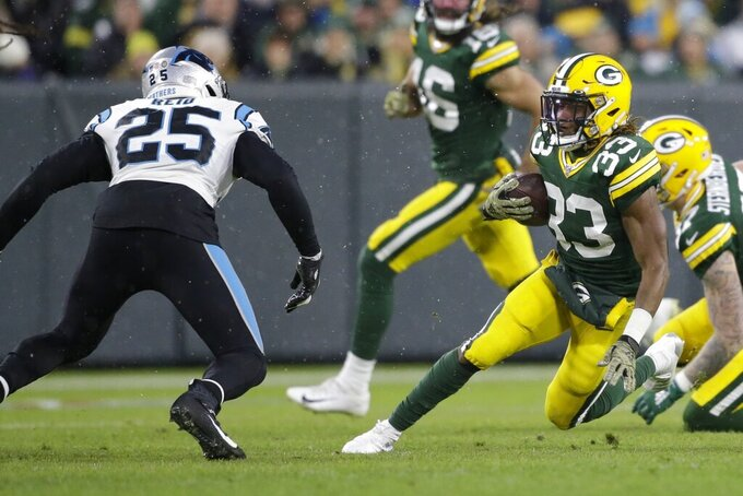 Green Bay Packers' Aaron Jones runs during the first half of an NFL football game against the Carolina Panthers Sunday, Nov. 10, 2019, in Green Bay, Wis. (AP Photo/Jeffrey Phelps)
