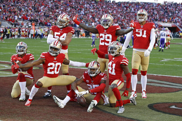 San Francisco 49ers players celebrate as a group after cornerback Richard Sherman (25), bottom center, intercepted a pass against the Minnesota Vikings during the second half of an NFL divisional playoff football game, Saturday, Jan. 11, 2020, in Santa Clara, Calif. (AP Photo/Marcio Jose Sanchez)