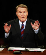 FILE - In this Sept. 26, 2008 file photo, veteran PBS anchor and debate moderator Jim Lehrer asks a question during the first U.S. Presidential Debate between presidential nominees Sen. John McCain, R-Ariz., and Sen. Barack Obama, D-Ill., at the University of Mississippi in Oxford, Miss. PBS announced that PBS NewsHour's Jim Lehrer died Thursday, Jan. 23, 2020, at home. He was 85. (AP Photo/Chip Somodevilla, Pool)