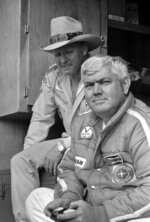 FILE - In this May 4, 1978, file photo, driver Cale Yarborough, left, and his team owner, former driver Junior Johnson, watch competitors in qualifying for the NASCAR Winston 500 auto race at Alabama International Motor Speedway in Talladega, Ala. Johnson, who won 50 NASCAR Cup Series races as a driver and 132 as an owner and was part of the inaugural class inducted into the NASCAR Hall of Fame in 2010, died Friday, Dec. 20, 2019, at 88. (AP Photo, File)