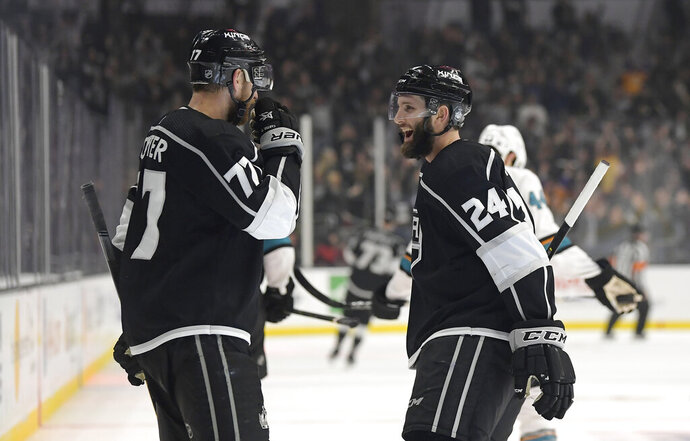 Los Angeles Kings center Jeff Carter, left, celebrates his empty-net goal with defenseman Derek Forbort during the third period of the team's NHL hockey game against the San Jose Sharks on Thursday, March 21, 2019, in Los Angeles. The Kings won 4-2. (AP Photo/Mark J. Terrill)