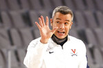 Virginia head coach Tony Bennett calls a play as Virginia plays Gonzaga during the second half of an NCAA college basketball game, Saturday, Dec. 26, 2020, in Fort Worth, Texas.  (AP Photo/Ron Jenkins)