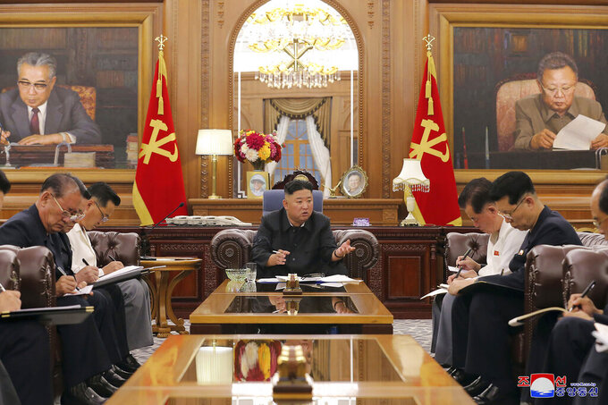 In this photo provided by the North Korean government, North Korean leader Kim Jong Un, center, attends a meeting with senior ruling party officials in Pyongyang, Monday, June 7, 2021. Independent journalists were not given access to cover the event depicted in this image distributed by the North Korean government. The content of this image is as provided and cannot be independently verified. (Korean Central News Agency/Korea News Service via AP)