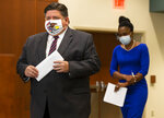 Illinois Governor JB Pritzker walks out with IDPH Director Dr. Ngozi Ezike for a press conference to speak about the state surpassing 5 million COVID-19 tests since the beginning of the pandemic at the Memorial Center for Learning and Innovation, Monday, September 21, 2020, in Springfield, Ill.  (Justin L. Fowler/The State Journal-Register via AP)