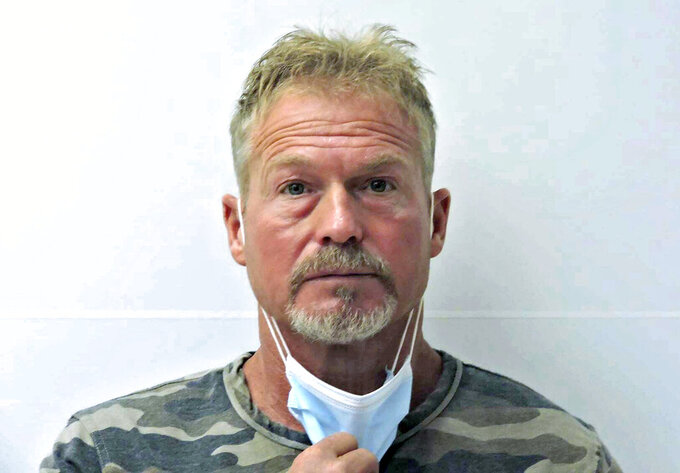 FILE - This undated file photo provided by the Chaffee County (Colo.) Sheriff's Office shows Barry Morphew in Salida, Colo. A judge ruled Friday, Sept. 17, 2021, there is enough evidence for the case to proceed against a southern Colorado man who was charged with first-degree murder nearly a year after his wife disappeared on Mother's Day 2020. Judge Patrick Murphy ruled Barry Morphew, 53, should stand trial for the presumed death of Suzanne Morphew, a 49-year-old mother of two daughters who was reported missing after she did not return from a bike ride near her home in the Salida area. (Chaffee County Sheriff's Office via AP, File)