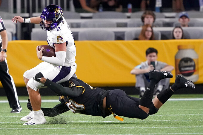 East Carolina quarterback Holton Ahlers is tackled by Appalachian State defensive lineman DeAndre Dingle-Prince during the second half of an NCAA college football game Thursday, Sept. 2, 2021, in Charlotte, N.C. (AP Photo/Chris Carlson)