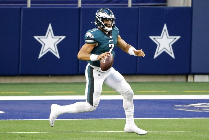 Philadelphia Eagles' Jalen Hurts (2) runs the ball in the first half of an NFL football game against the Dallas Cowboys in Arlington, Texas, Sunday, Dec. 27. 2020. (AP Photo/Michael Ainsworth)