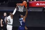 Rhode Island's Antwan Walker goes up for a basket against South Florida's Justin Brown during the first half of an NCAA college basketball game Saturday, Nov. 28, 2020, in Uncasville, Conn. (AP Photo/Jessica Hill)