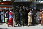 Afghans wait in long lines for hours to withdraw money, near Kabul Bank, in Kabul, Afghanistan, Sunday, Aug. 15, 2021. Officials say Taliban fighters have entered Kabul and are seeking the unconditional surrender of the central government. (AP Photo/Rahmat Gul)