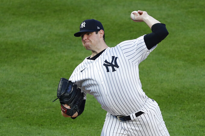 New York Yankees starting pitcher Jordan Montgomery winds up during the first inning of the team's baseball game against the Atlanta Braves, Tuesday, Aug. 11, 2020, in New York. (AP Photo/Kathy Willens)