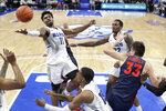 Saint Louis' Hasahn French (11) reaches for a rebound as teammates Demarius Jacobs (15) and Jimmy Bell Jr. and Dayton's Ryan Mikesell (33) watch during the first half of an NCAA college basketball game Friday, Jan. 17, 2020, in St. Louis. (AP Photo/Jeff Roberson)