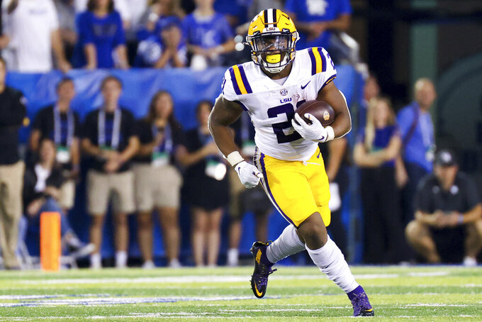 LSU running back Corey Kiner carries the ball during the first half of the team's NCAA college football game against Kentucky in Lexington, Ky., Saturday, Oct. 9, 2021. (AP Photo/Michael Clubb)